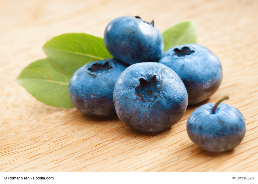 Organic blueberries on wooden background. Close up, high resolution product. Harvest Concept